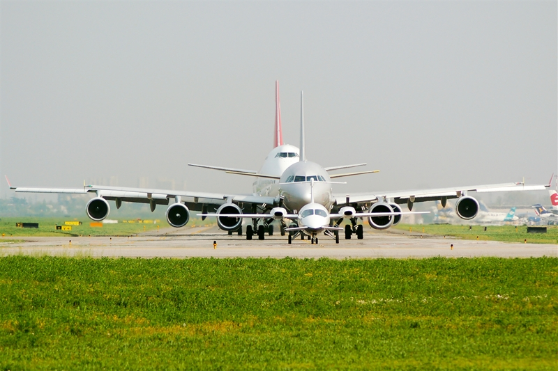 Planes of different sizes in line for take-off